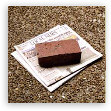 Mark drop-off location with a brick and newspaper